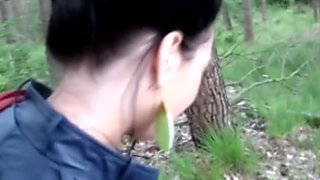 Foxy Russian whore give blowjob while sitting on dirt with her naked ass