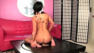 Slutty nympho Venus Harris rides a cock on the glory hole table