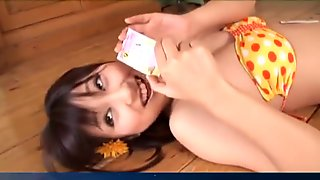 Kana Anzai in bath suit is playing cards