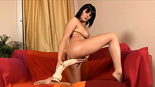 Thick and horny amateur bounces on a big brutal dildo