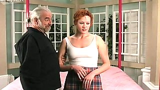 Red haired chick in short skirt is spanked by horny old man