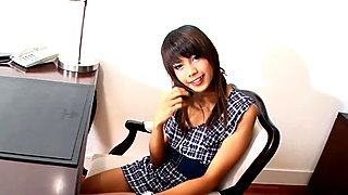 Ladyboy cutie plays with her small titties and cock at work