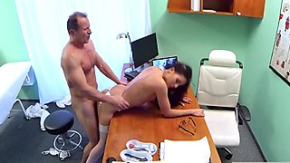 Sexy ass brunette fucked by doctor in his office
