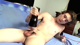 Skinny twink Sean playing around with a toy in his bedroom