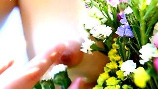 beautiful fresh blonde girl loves flowers
