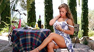 Adorable Nicole Aniston dips her dildo outdoors