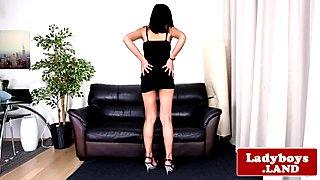 Glam ladyboy jerking her cock teasingly