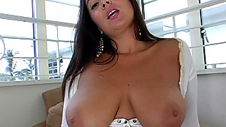 Lustful brunette bombshell Sonia Carrere shows off her big boobs