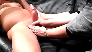 My stepmom jerks me off with her slippery hands with cumshot.