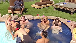 Group of couples have fun by the pool