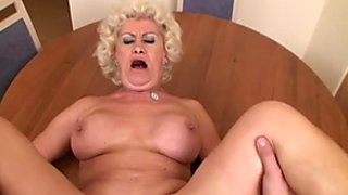 Big breasted granny gets her muff fucked in missionary position