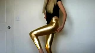 Breathtaking blond teasing in gold latex