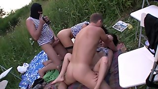 Amateur students enjoy orgy in park