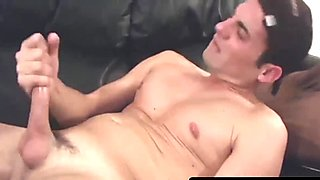 Amateur sexy twink David jerks his hard prick on a sofa